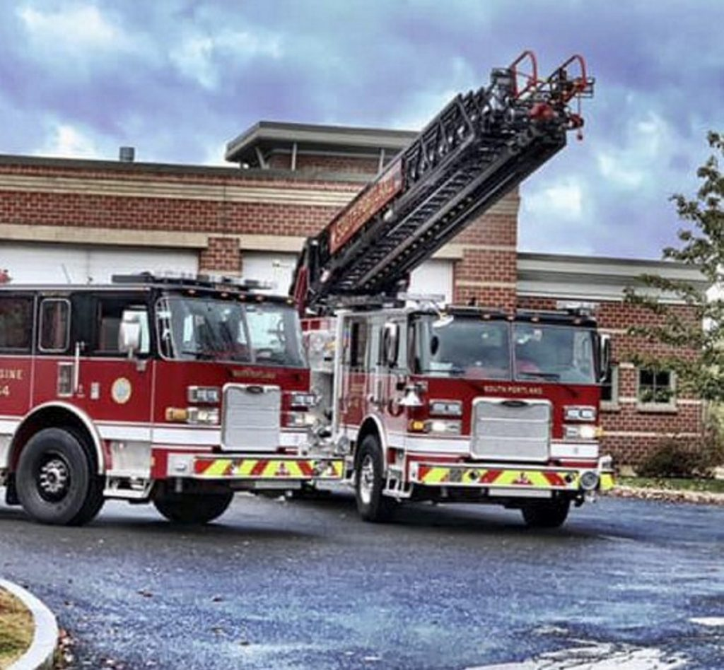 The South Portland Fire Department's new ladder truck, right, has been out of service since the October incident and officials have yet to determine whether the million-dollar truck is a total loss.