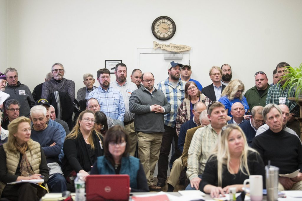 A crowd listens to comments about the pros and cons of the proposed 145-mile power line that would go through parts of Somerset County at a meeting of the county commissioners in Skowhegan on Wednesday. Hydro-Quebec, which would send hydropower down the line to Massachusetts, said last week that the project would provide abundant clean energy.