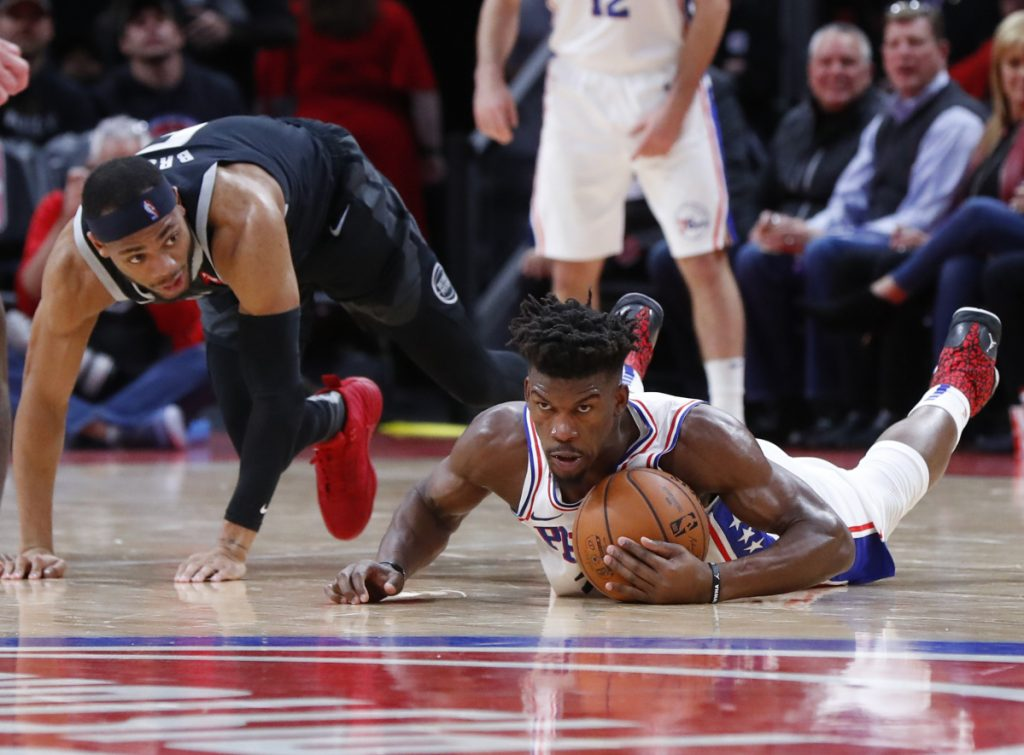 Philadelphia 76ers guard Jimmy Butler collects the ball from Detroit Pistons guard Bruce Brown during the first half of their game in Detroit on Friday night. The 76ers won 117-111 despite resting Joel Embiid.