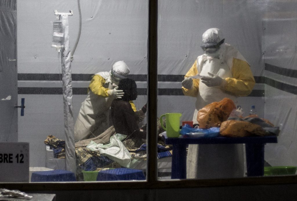 Health workers treat a patient an Ebola treatment center in Butembo, Congo, on Nov. 3. Dr. Peter Salama, the World Health Organization's emergencies director, says the agency is very concerned about the size of the vaccine stockpile.