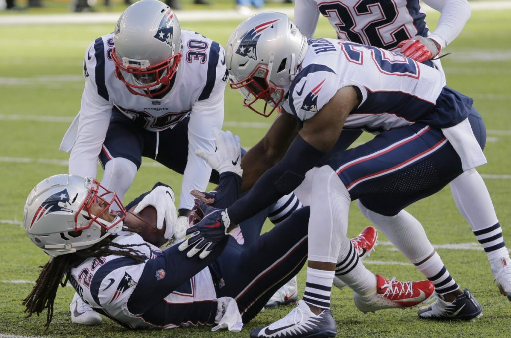 Stephon Gilmore, below, and teammates Duron Harmon, right, and Jason McCourty have had more than just an interception against the Jets to celebrate. The unit has steadily improved after a shaky start to become a key component to the Patriots success.