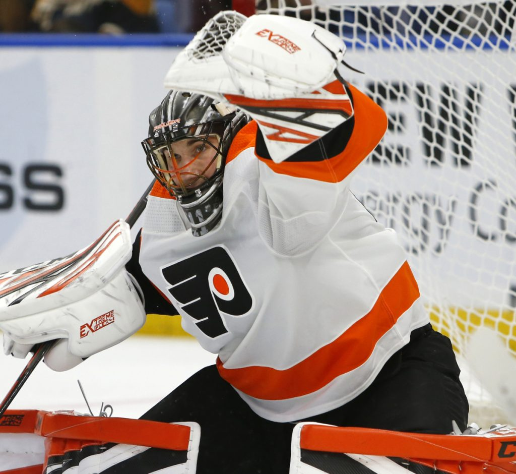 Philadelphia goalie Anthony Stolarz makes a glove save in the first period of the Flyers' 6-2 win over Buffalo on Saturday in Buffalo, N.Y. Stolarz made 28 saves.