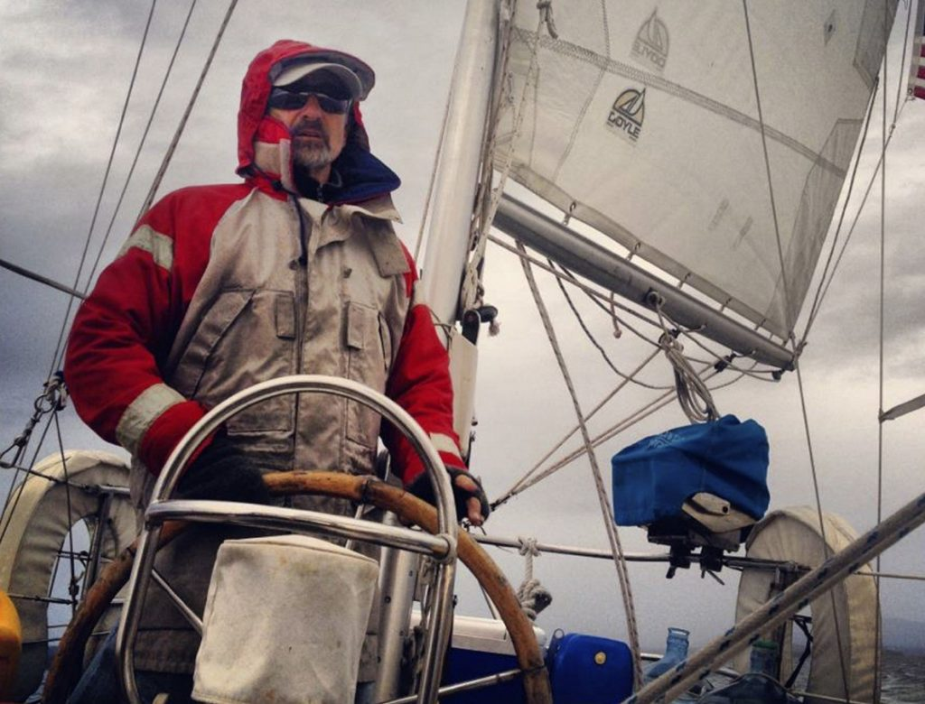Capt. Richard Smith stands at the helm of his sailboat, the Cimarron. Smith, who charters in Camden and the U.S. Virgin Islands, was charged in connection with the death of a crew member aboard the boat in 2015.
