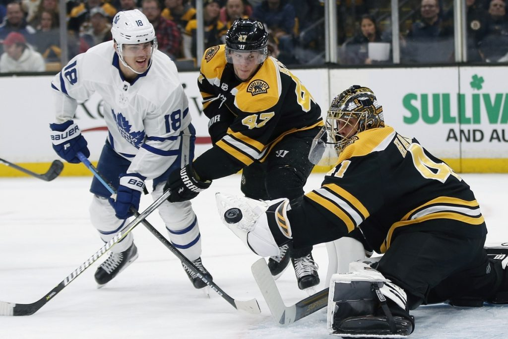 Bruins goalie Jaroslav Halak makes a save as defenseman Tory Krug fights for the rebound with Andreas Johnsson of the Maple Leafs during Boston's 6-3 win Saturday night.