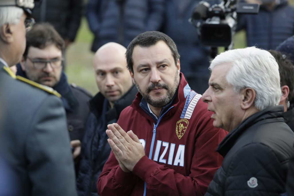 Italian Interior Minister and Deputy-Premier Matteo Salvini, flanked by Ancona's head of police Oreste Capocasa, leaves disco Lanterna Azzurra after a site inspection Saturday. Five young teens and one adult died in a 1 a.m. stampede at an overcrowded rap concert there Saturday.  Associated Press/Andrew Medichini