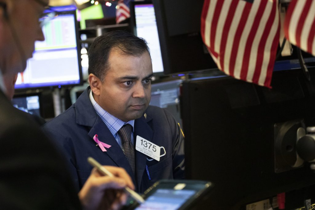 Specialist Dilip Patel works at the New York Stock Exchange on Monday.