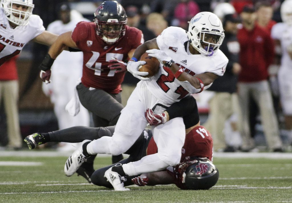 Eastern Washington running back Tamarick Pierce, top, is part of an offense that averages 538.3 yards per game. Maine defense allows 293.5 yards per game.