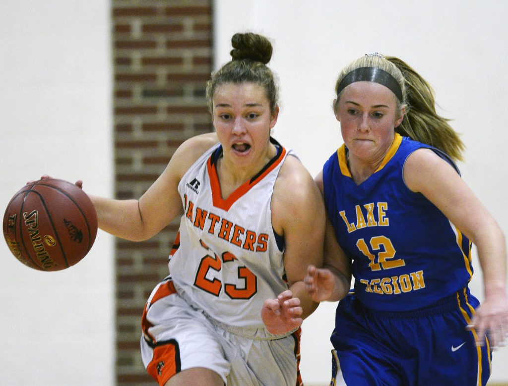 Serena Mower of North Yarmouth Academy, left, drives against Shauna Hancock of Lake Region during NYA's 51-17 victory at home Monday night.