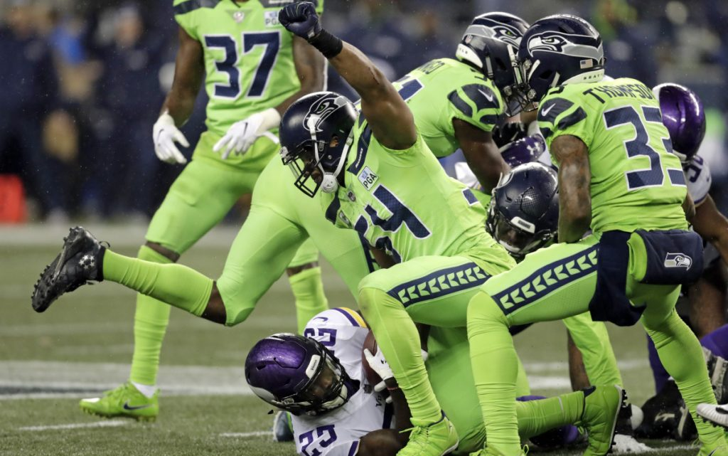 Seattle's Bobby Wagner raises his fist after stopping Minnesota's Latavius Murray on a fourth-down run in the second half of the Seahawks' 21-7 win Monday at Seattle.