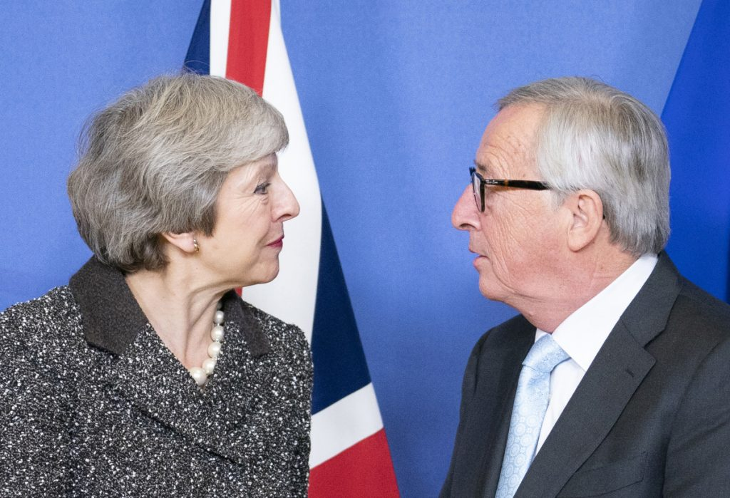 Theresa May, U.K. prime minister, with Jean-Claude Juncker, president of the European Commission, ahead of talks in Brussels on Dec. 11.