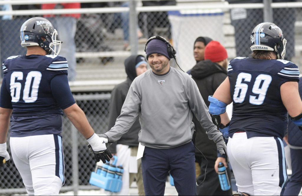 2595600bc University of Maine coach Joe Harasymiak congratulates players in the game  against Jacksonville State on Dec