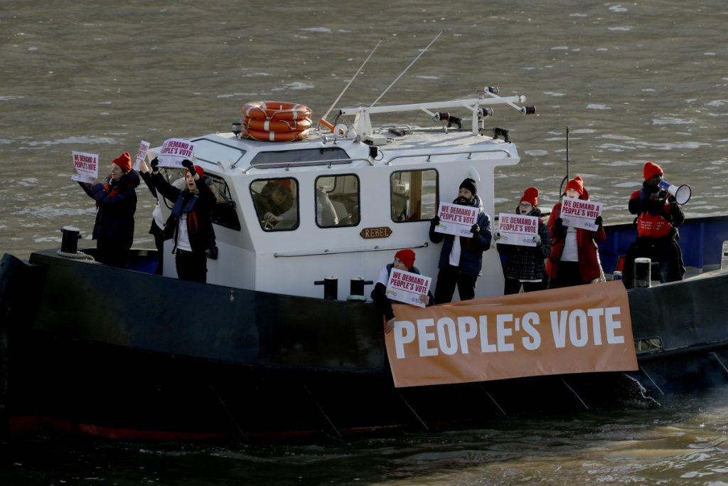 Campaigners mount a protest on a boat calling for a people's vote, a second referendum on Britain's EU membership, on the River Thames outside the Houses of Parliament in London on Thursday.