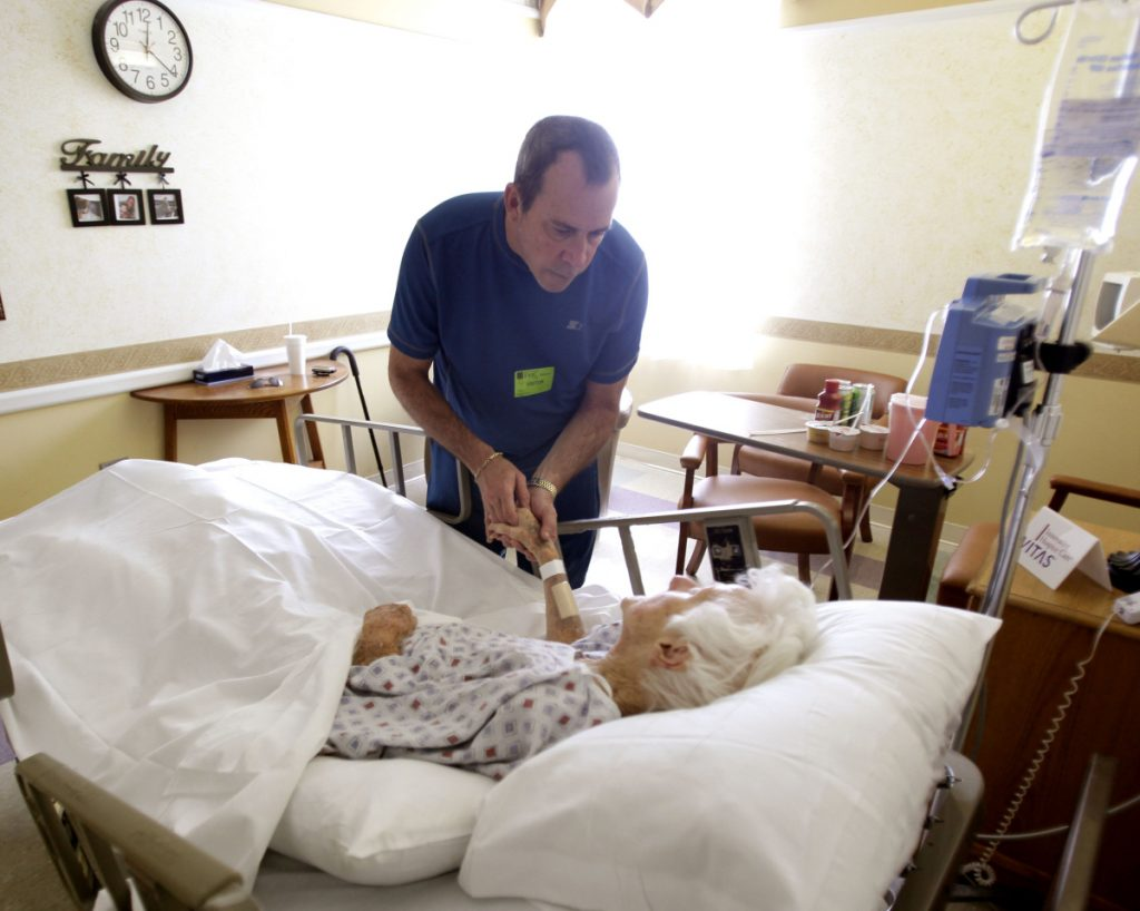 A visitor talks with a patient at a hospice where the dying may be as likely to savor satisfying lives as to grapple with regrets.