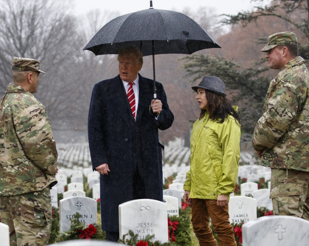 President Trump visits Arlington National Cemetery in Arlington, Va., on Saturday during Wreaths Across America Day.