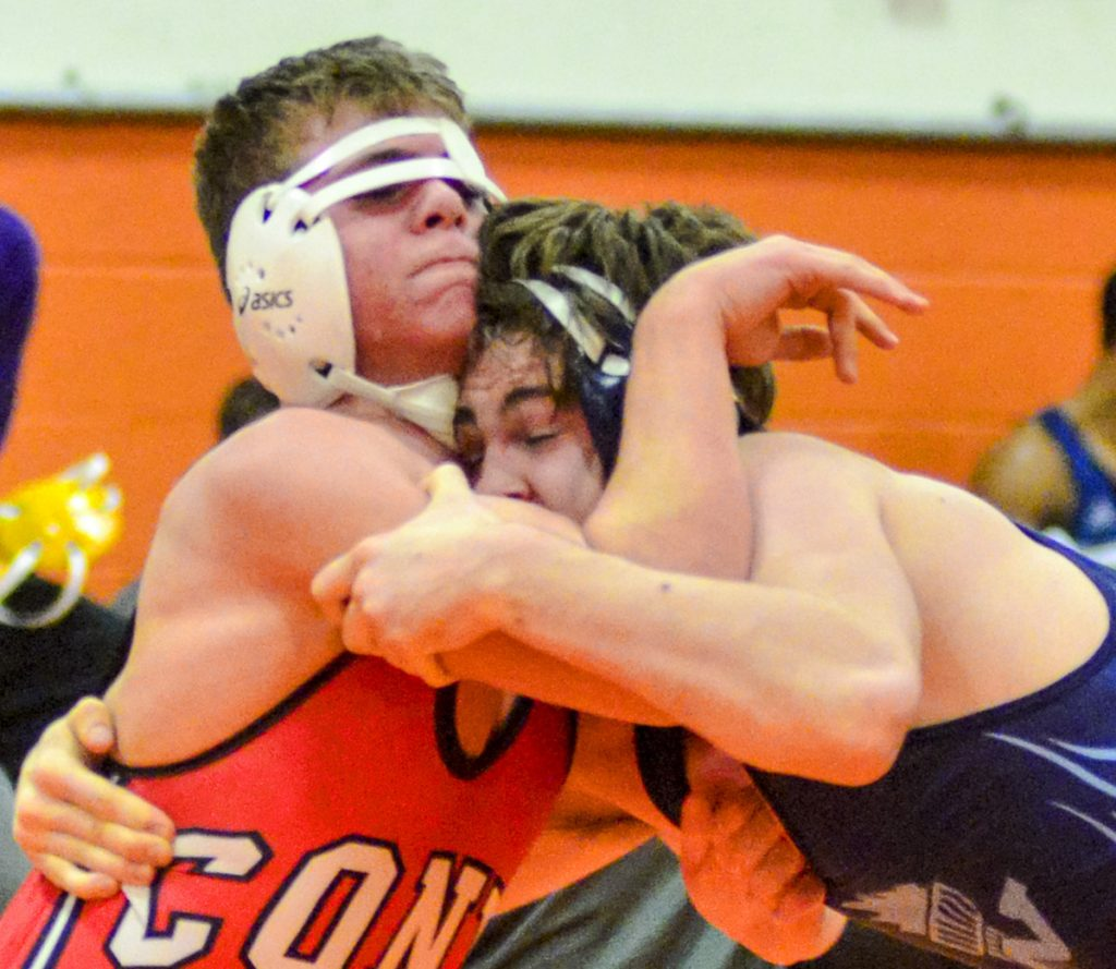 Casey Mills, left, of Cony battles with Westbrook's Henri Kuntz in a 170-pound match Saturday at the Gardiner Tiger tournament. Cony edged Kennebunk for the team title.