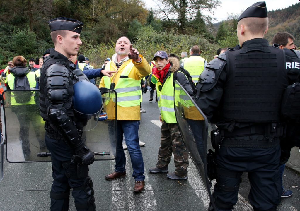 French police officers disperse demonstrators wearing yellow vests in Biriatou on Saturday.