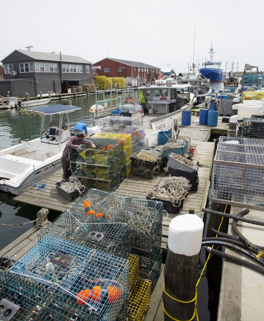 Lobster traps and fishing gear take up most of the dock space at Fish Pier in Portland.