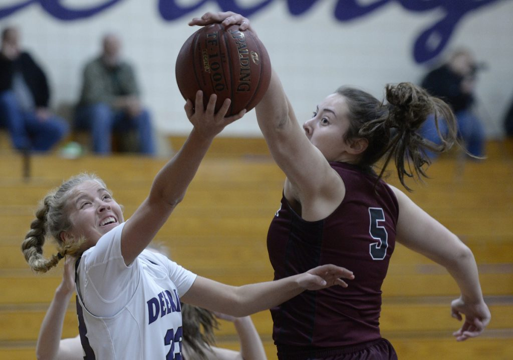 Gorham's Mackenzie Holmes, right, had 33 points, 28 rebounds and five blocks, this one on Delaney Haines.
