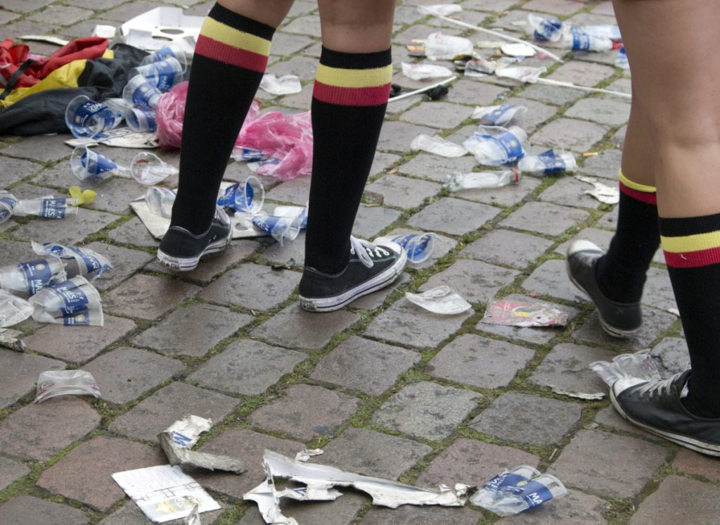 The plastic cups on this Belgian pavement wouldn't be affected by the European Union's proposed ban, but bags and other debris would be phased out.