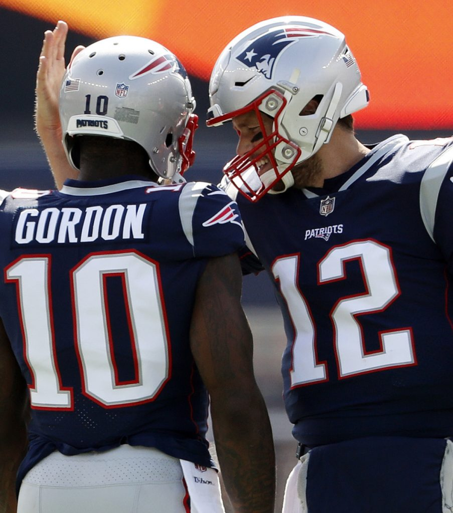 Josh Gordon, who was suspended Thursday for a substance abuse violation, was given a locker next to Tom Brady's, and had numerous conversations with Patriots Coach Bill Belichick.