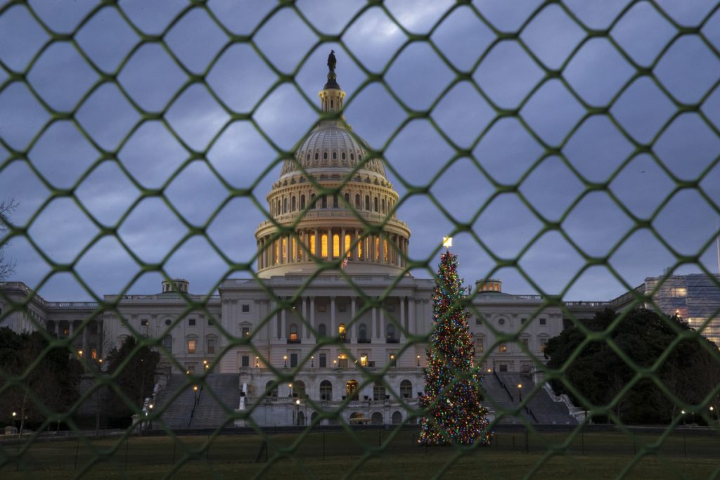 The Capitol is seen on the first morning of a partial government shutdown, as Democratic and Republican lawmakers are at a standoff with President Trump on spending for his border wall. Government operations will be disrupted during the shutdown and hundreds of thousands of federal workers will be furloughed or forced to work without pay just days before Christmas.