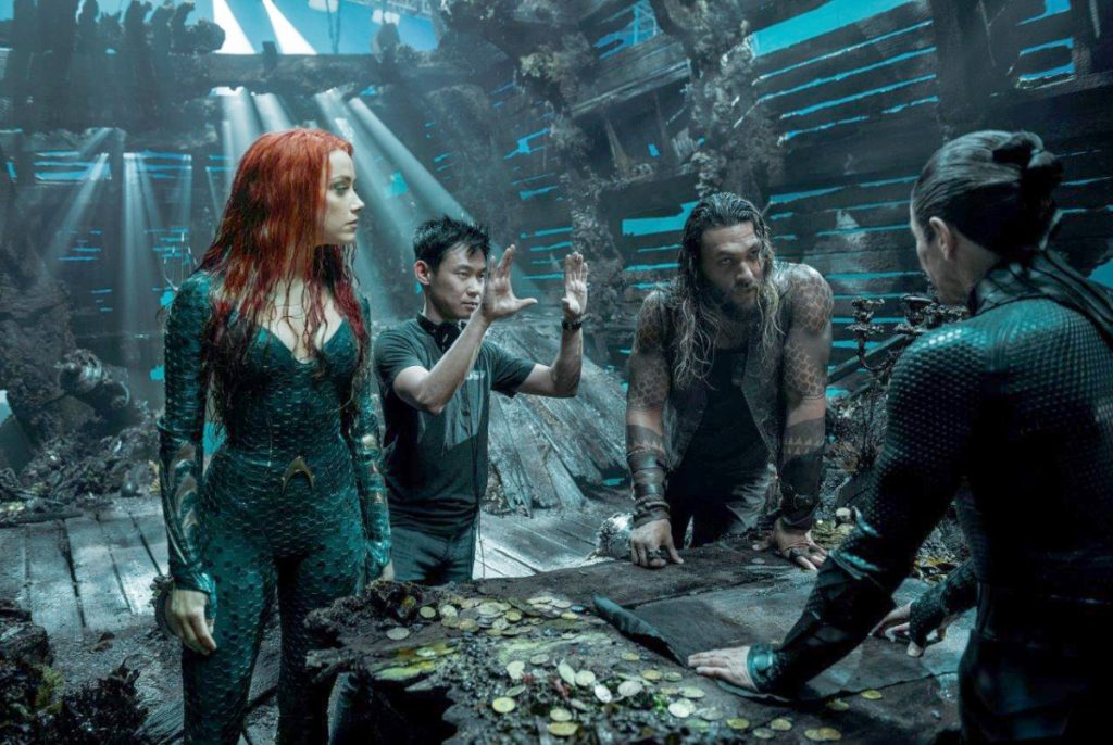 "James Wan, second from left, directs a scene during the filming of ""Aquaman."""