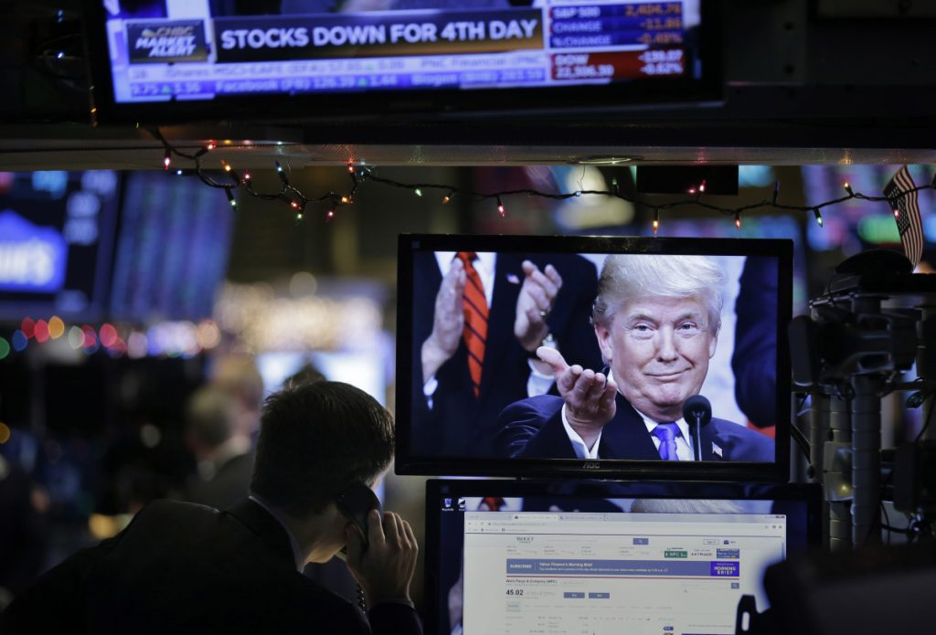 A picture of President Trump is displayed on a computer on the floor of the New York Stock Exchange in New York on Monday.