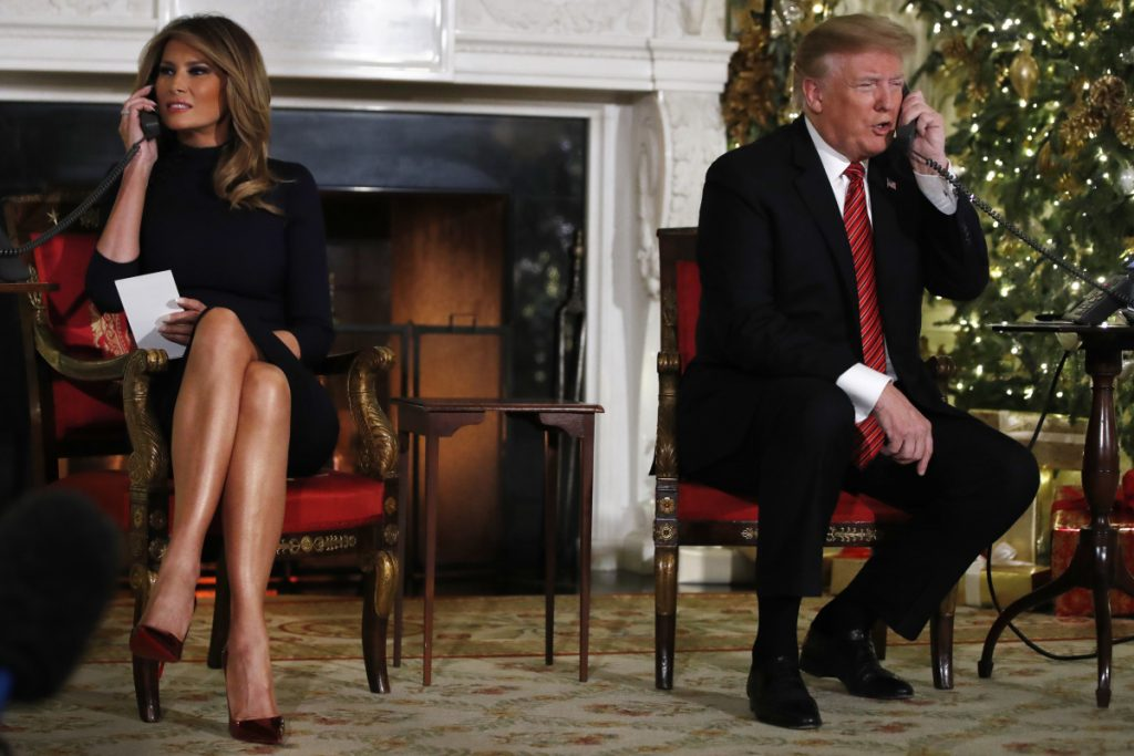 President Trump and first lady Melania Trump both speak on the phone while sharing updates to track Santa's movements from the North American Aerospace Defense Command (NORAD) Santa Tracker on Christmas Eve.