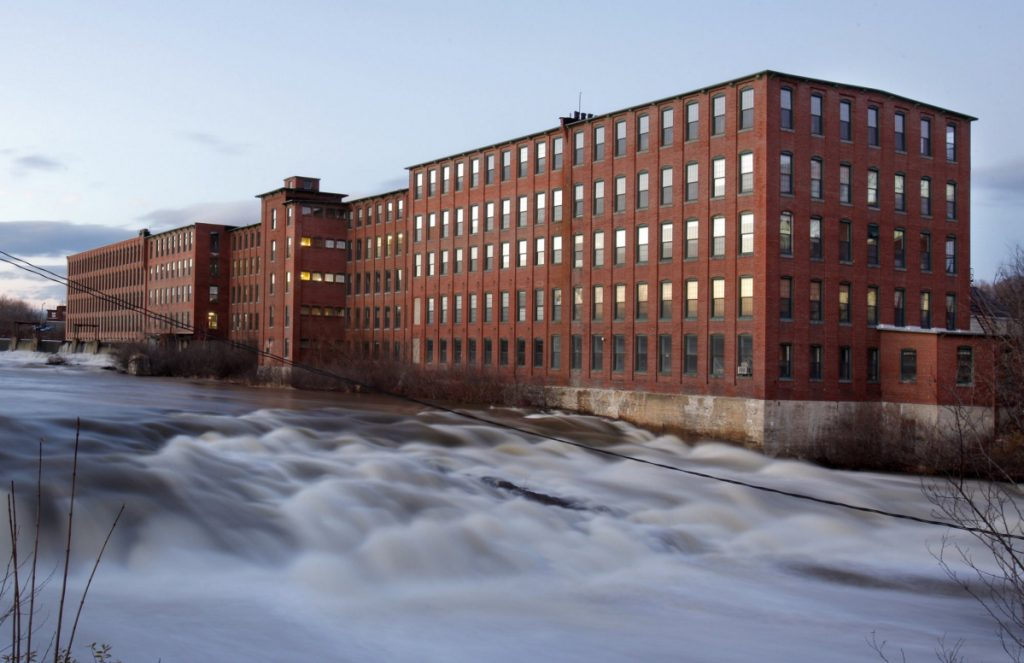 The Presumpscot River flows past the Dana Warp Mill complex in Westbrook in December 2009. A New Hampshire developer purchased the 246,000-square-foot structure this month for $5.1 million, about double what the building sold for in 2011.