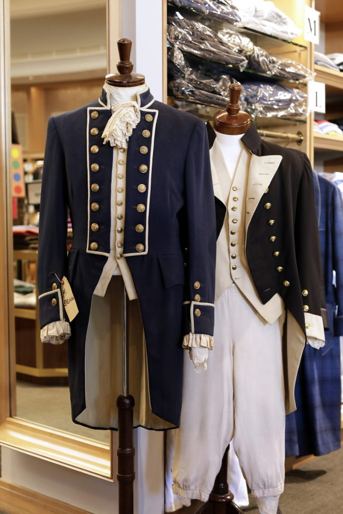 "Costumes from ""Mutiny on the Bounty,"" Marlon Brando's 1962 outfit on the left and Charles Laughton's 1935 outfit on the right, are displayed at Carroll & Co. in Beverly Hills. The 70-year-old clothing store in Beverly Hills that has catered to celebrities and the affluent, will be shutting down early next year."