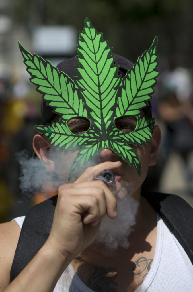 A man celebrates International Day for Cannabis last April in Mexico City.