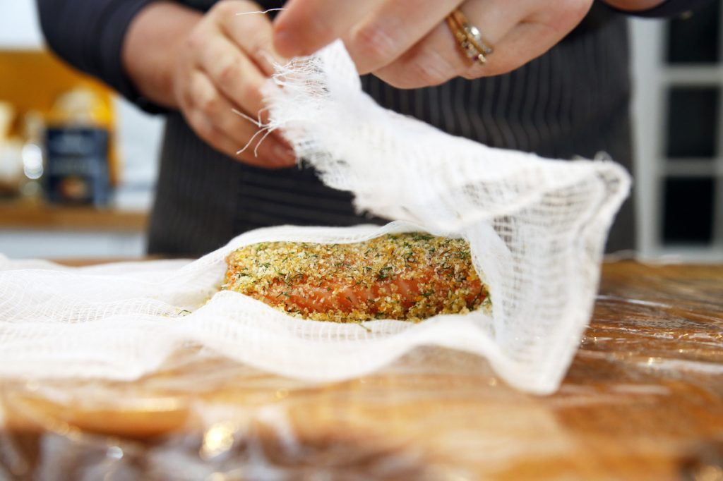 Rudalevige wraps the salmon in cheesecloth to make gravlax.