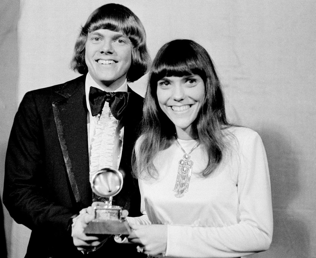 "In this March 17, 1971 file photo, Richard and Karen Carpenters of The Carpenters pose with their Grammy during the 13th annual 1970 Grammy Awards in Los Angeles. The brother-sister duo was named best new artist of the year, 1970, and also won as the best contemporary duo or group vocalists for ""Close to You."""