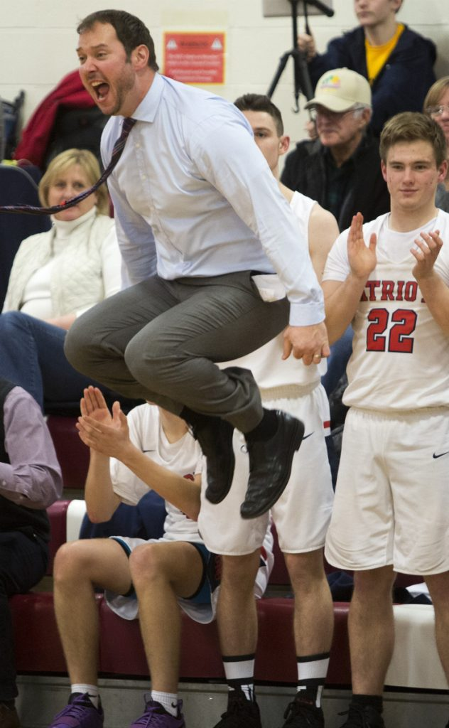 Gray-New Gloucester Coach Ryan Deschenes shows his excitement Friday night following Jonathan Martin's basket off a rebound during the 58-52 win over Yarmouth in Gray.