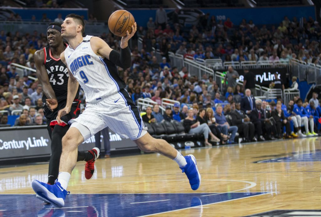 Nikola Vucevic, who finished with 30 points and 20 rebounds for the Orlando Magic, drives against Pascal Siakam of the Toronto Raptors in the second half of Orlando's 116-87 victory at home Friday night.