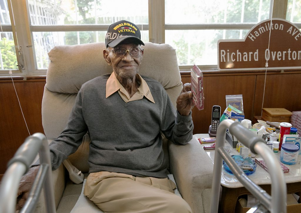 Richard Overton, then the oldest living U.S. veteran at the age of 111, sits in the home he had owned since 1948 after a renovation provided by Meals on Wheels of Central Texas and the Home Depot Foundation.
