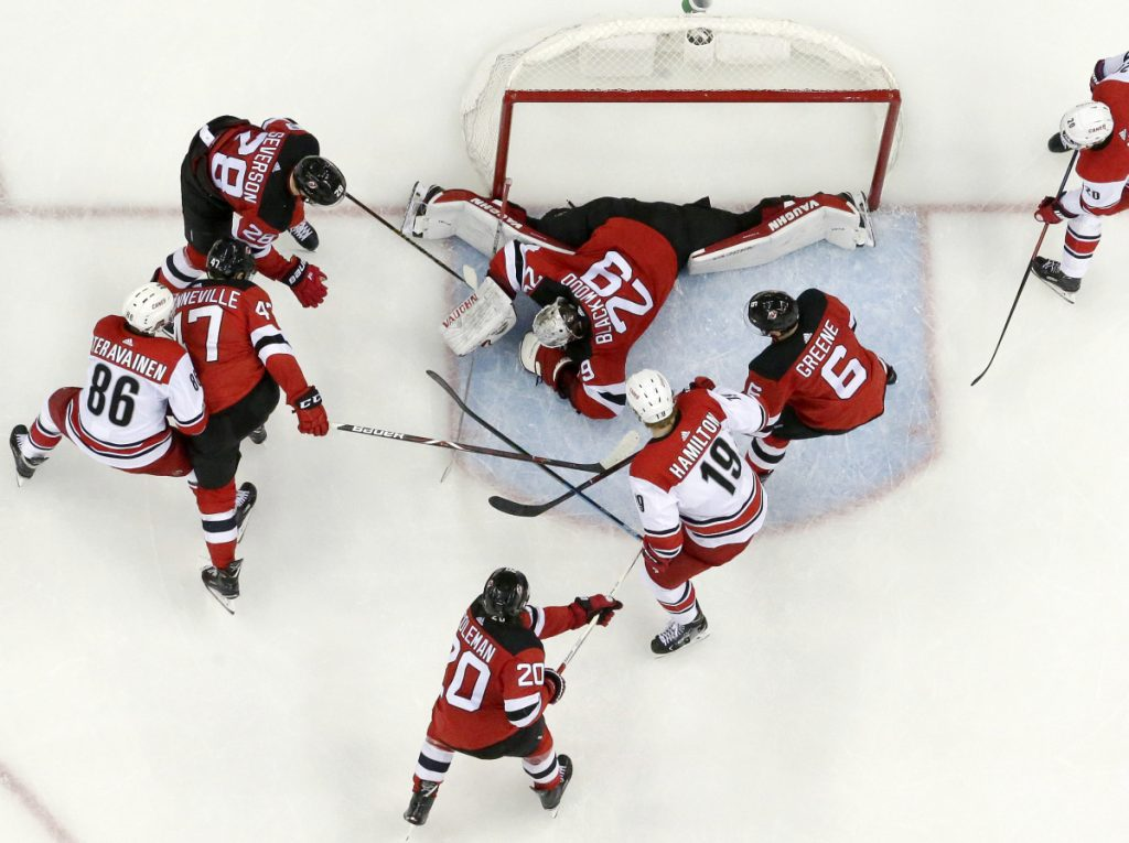 New Jersey Devils goaltender MacKenzie Blackwood lies on the puck Saturday after making a save during the first period of the 2-0 victory against the Carolina Hurricanes. Blackwood finished with 37 saves,