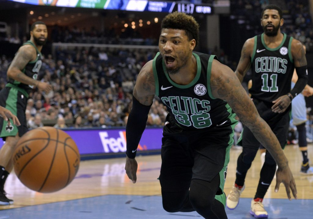 Boston guard Marcus Smart reacts as the bounces out of bounds during the first half of Saturday's game against the Grizzlies in Memphis, Tenn.