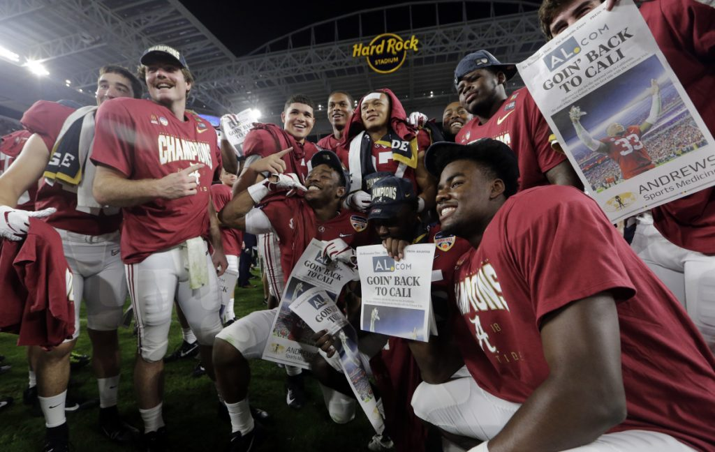 The Alabama team poses at the end of the Orange Bowl on Saturday in Miami Gardens, Fla. Alabama beat Oklahoma 45-34 to reach the title game.
