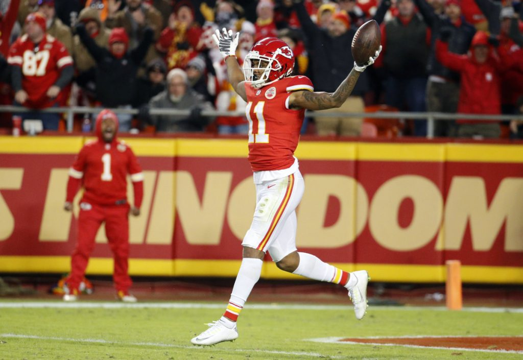 Demarcus Robinson of the Kansas City Chiefs runs backwards into the end zone after catching an 89-yard pass from Patrick Mahomes.