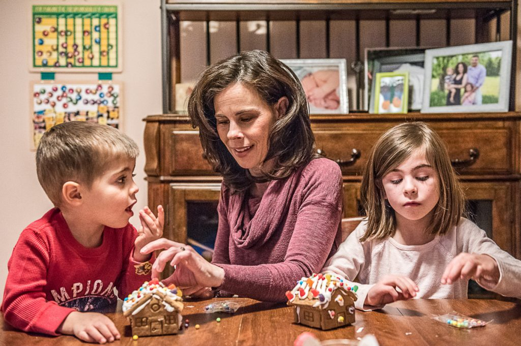 """Amy Richard makes gingerbread houses with her children, Owen and Olivia, in their home in Hebron shortly before Christmas. Nearly a year after she was diagnosed with lung cancer, Richard said she is """"hanging in there."""""""