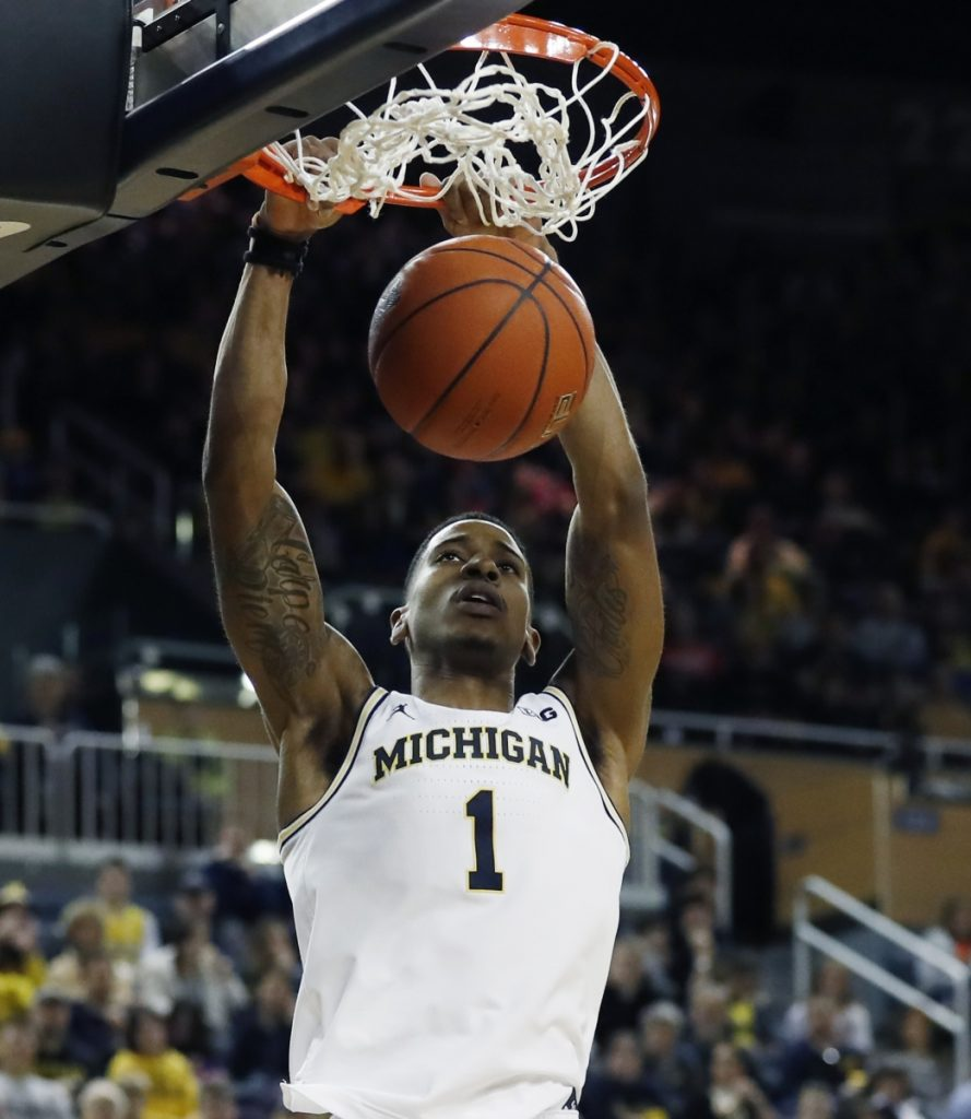 Michigan guard Charles Matthews dunks during the second half of the Wolverines' 75-52 win over Binghamton on Sunday in Ann Arbor, Mich.