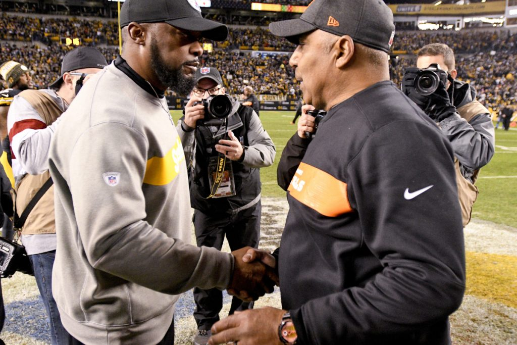Pittsburgh head coach Mike Tomlin, left, greets Cincinnati head coach Marvin Lewis Sunday night in Pittsburgh. Lewis was fired Monday.