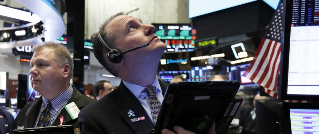 Jonathan Corpina works on the floor of the New York Stock Exchange on Friday. U.S. stocks ended the year with a narrow gain Monday.