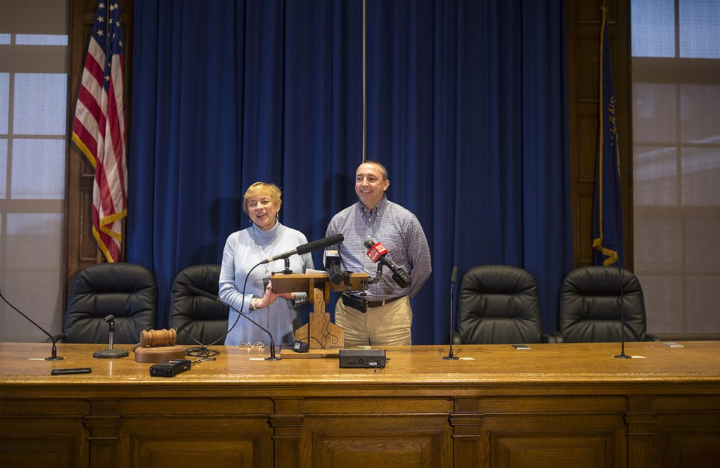 Gov.-elect Janet Mills and Portland Assistant City Manager Michael Sauschuck talk with the media during a press conference at Portland City Hall on Friday. Mills announced that she will nominate Sauschuck, a former Portland police chief, to head the Maine Department of Public Safety.