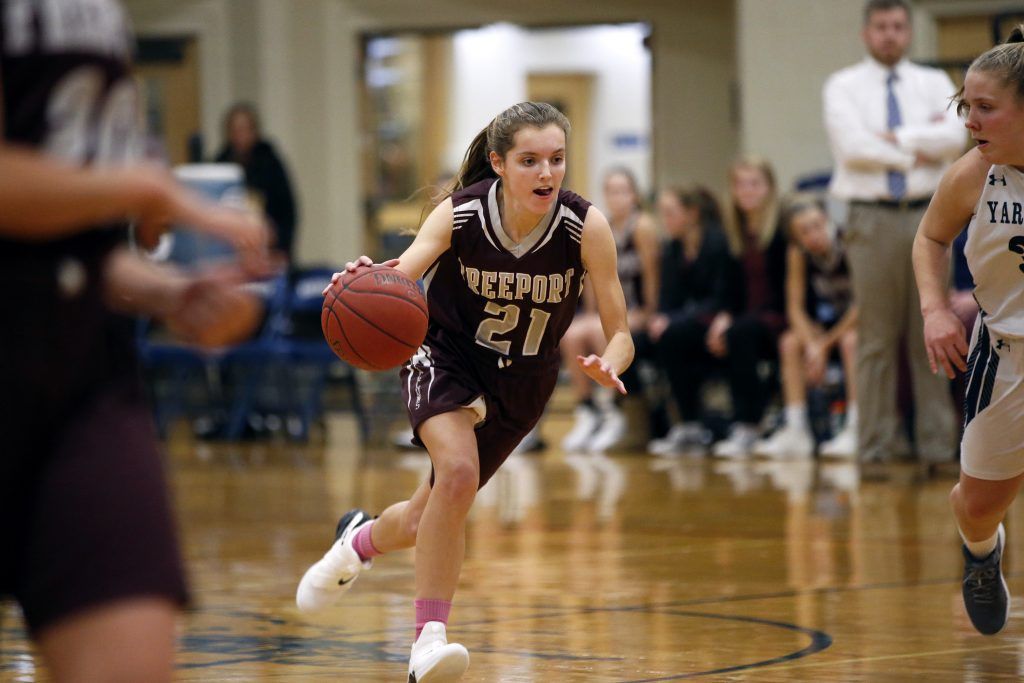 Freeport's Catriona Gould drives past midcourt in Tuesday's game at Yarmouth. Gould's seven steals were key for the Falcons in the 39-30 win. She also chipped in with seven points.