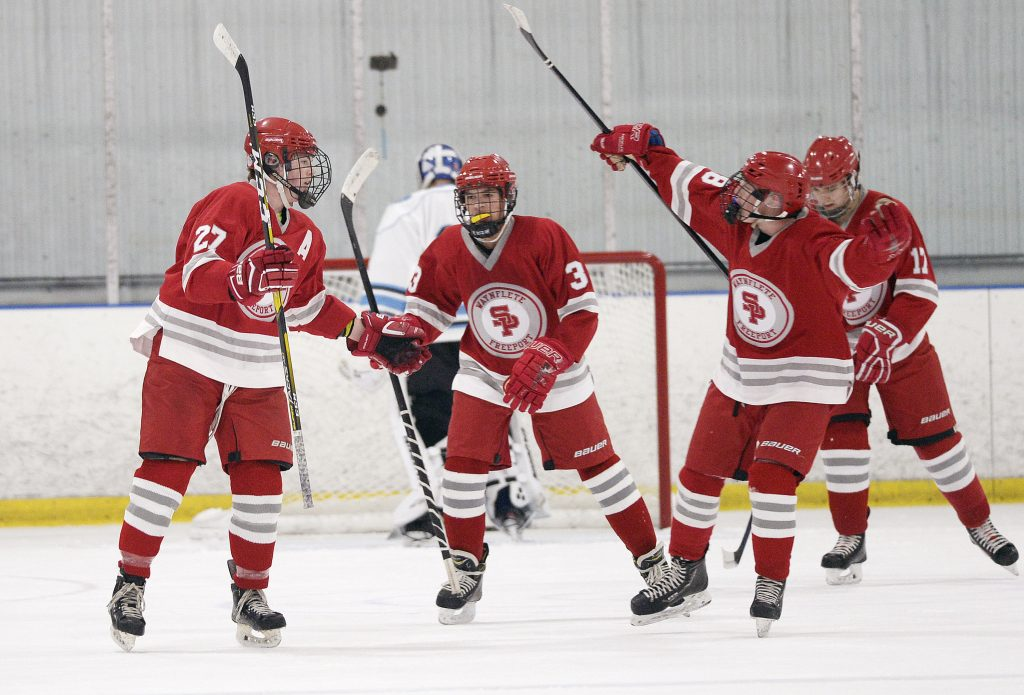 South Portland celebrates a goal against York Thursday night. Left to right: Willets Meyer, Cullen Adams, Bradley McMains and in the right background Ian Souther.