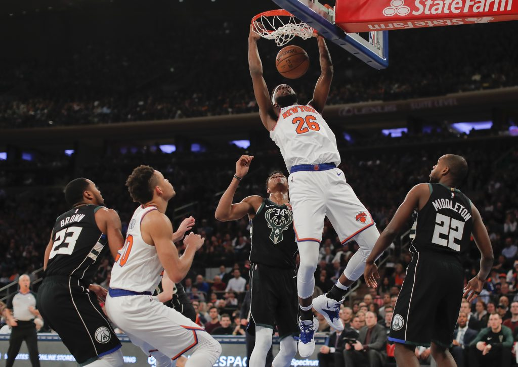 New York Knicks center Mitchell Robinson (26) dunks against the Milwaukee Bucks during the first quarter Saturday in New York.
