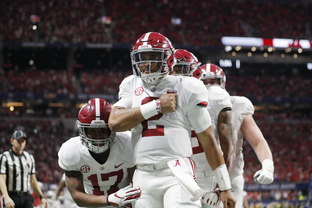 Alabama quarterback Jalen Hurts (2) celebrates his touchdown against Georgia during the second half of the Southeastern Conference championship  Saturday in Atlanta.