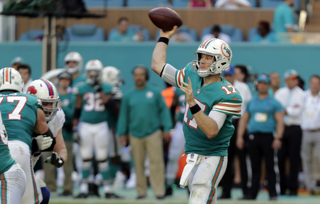 Quarterback Ryan Tannehill  and the Miami Dolphins don't put up huge numbers, but at 6-6 they are in the hunt for a playoff berth.